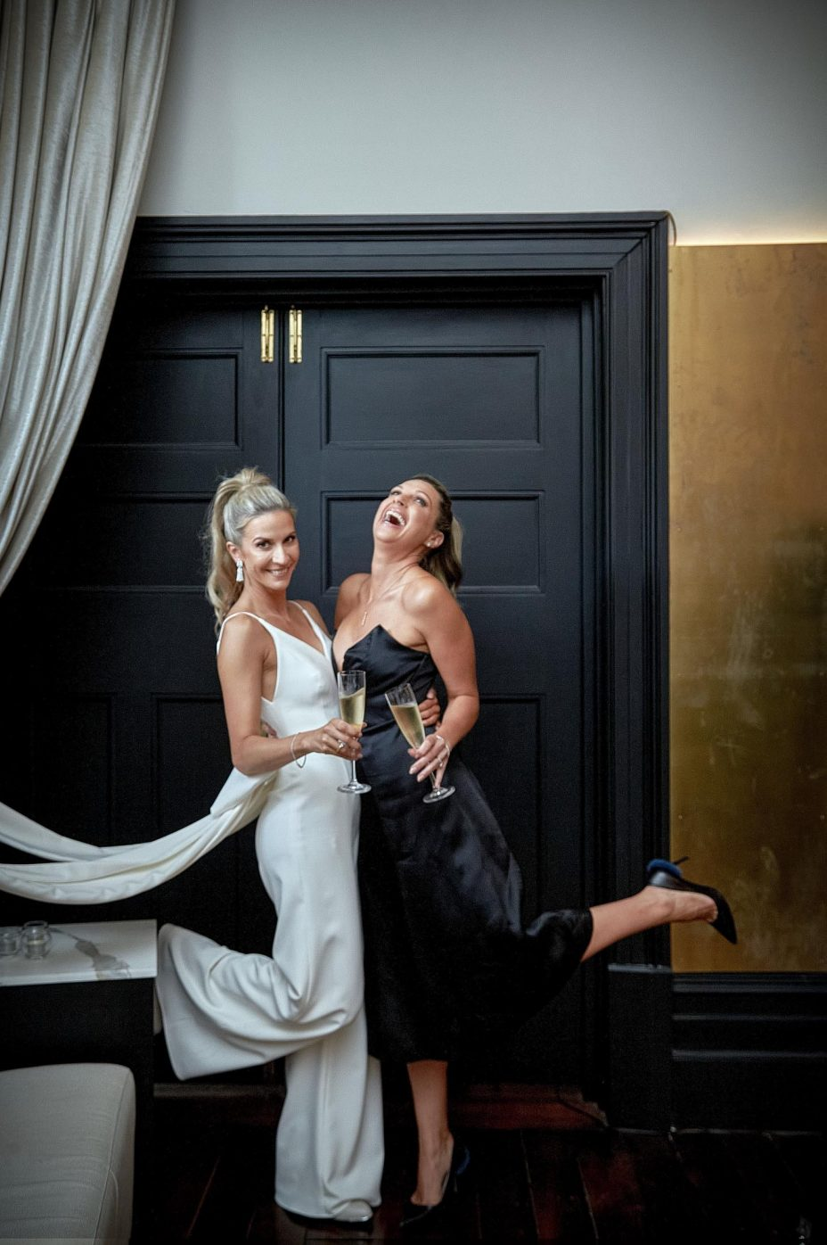 Bridesmaid and bride fun laughing photo at the Northern Club