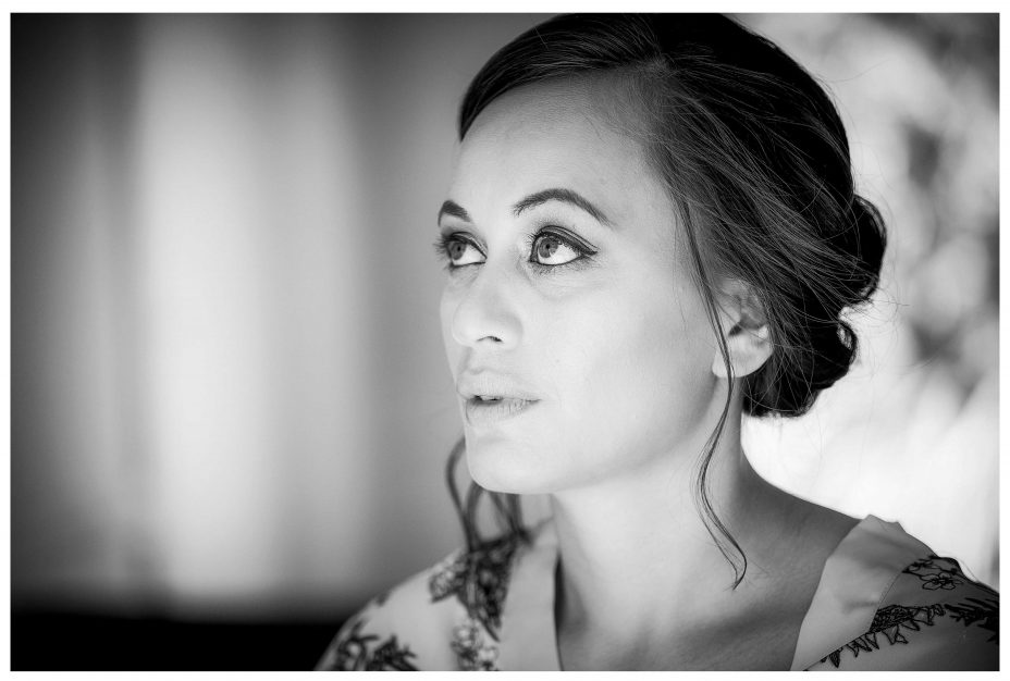 black and white photo of bride getting ready, Lichfields Cottages, Kumeu