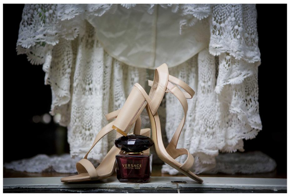 Gold wedding shoes and lacey wedding dress