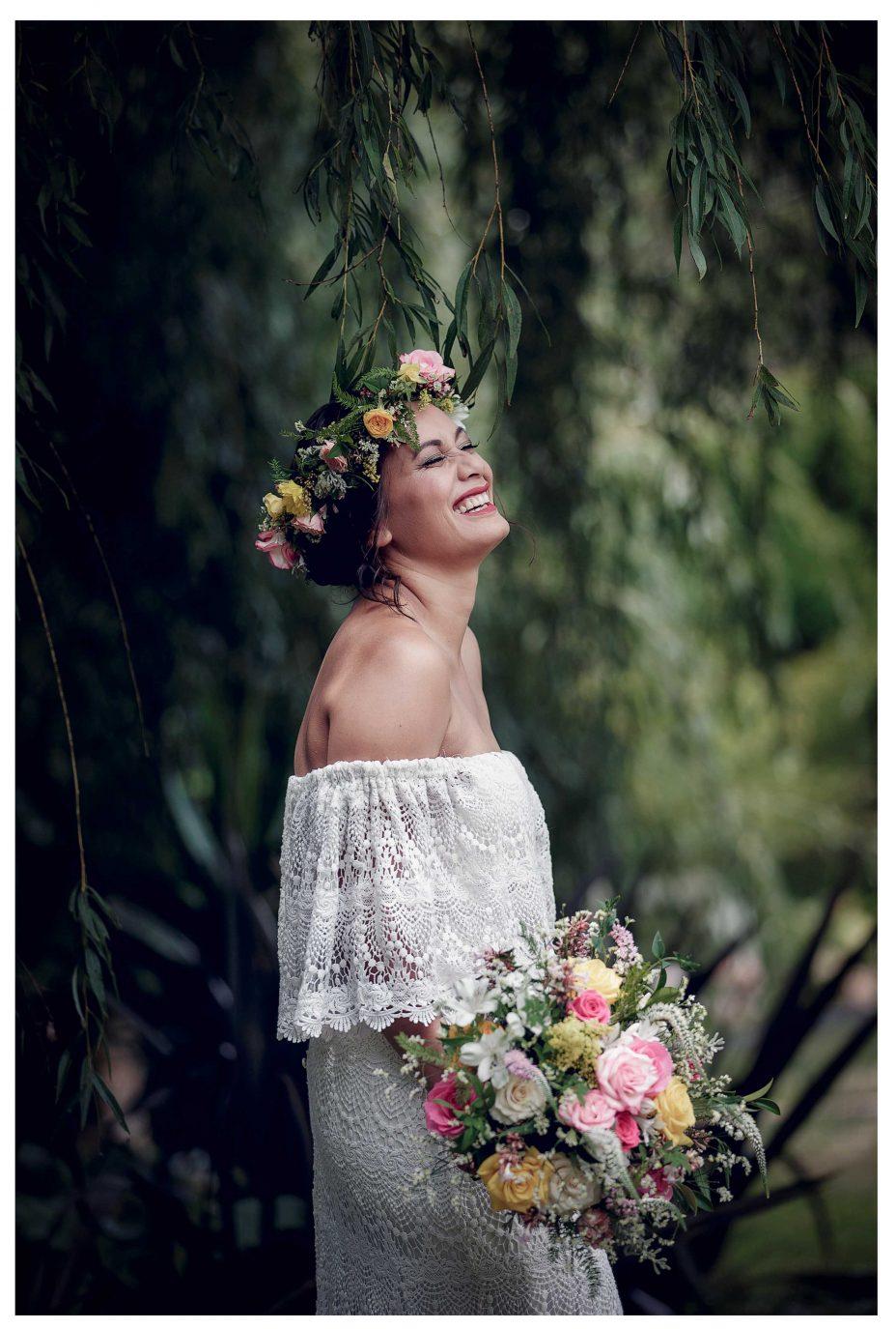 Bride laughs in joy, flower crown, Leaf and Honey flowers, flower bouquet, Kumeu garden, wedding