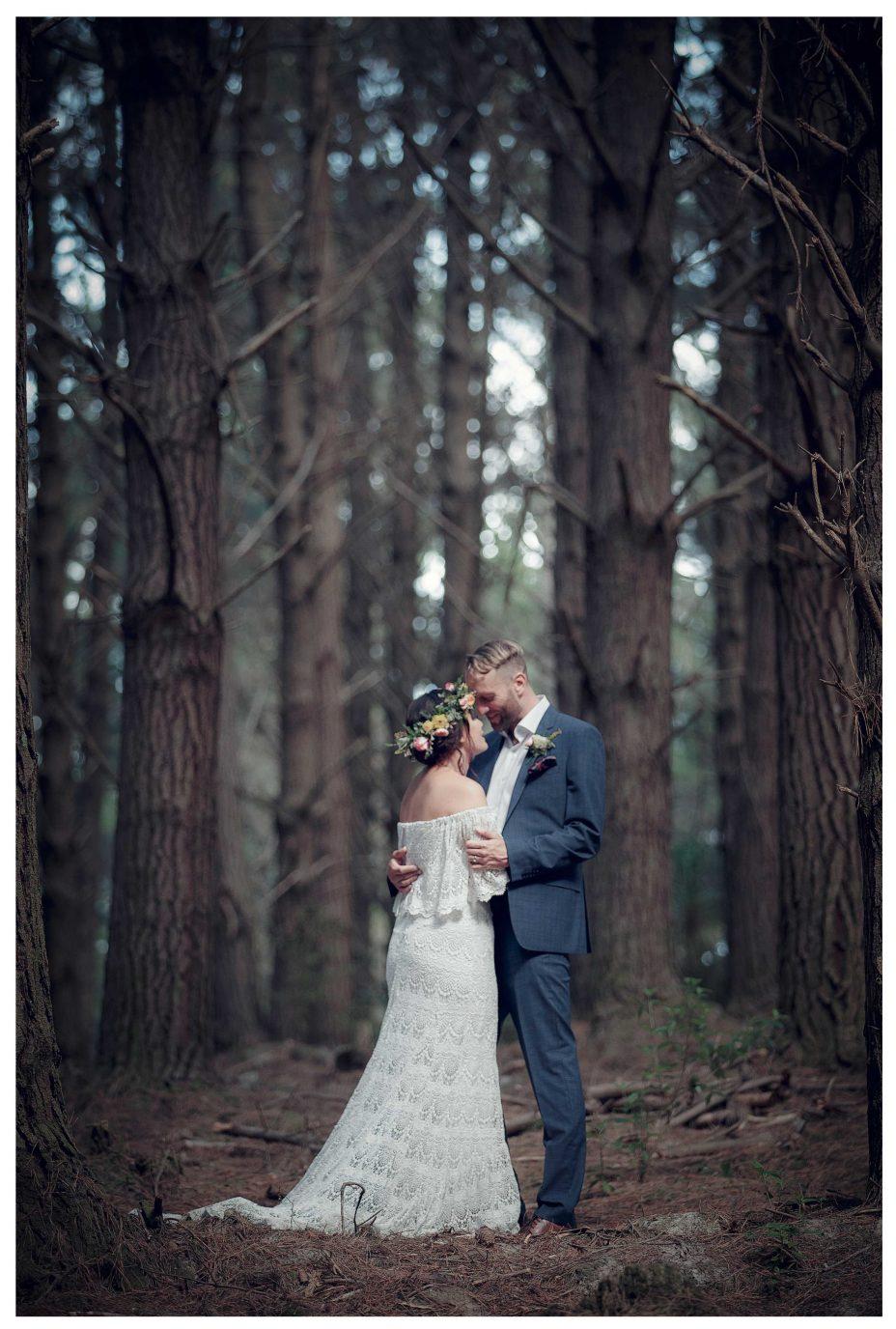 Creative wedding photo shoot, Bride and groom amoung huge trees, Riverhead Forrest wedding photo, Kumeu Valley
