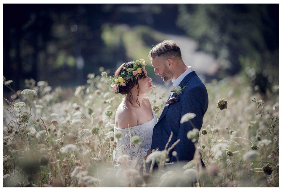 Bride and groom romantic photo in long grass Kumeu wedding